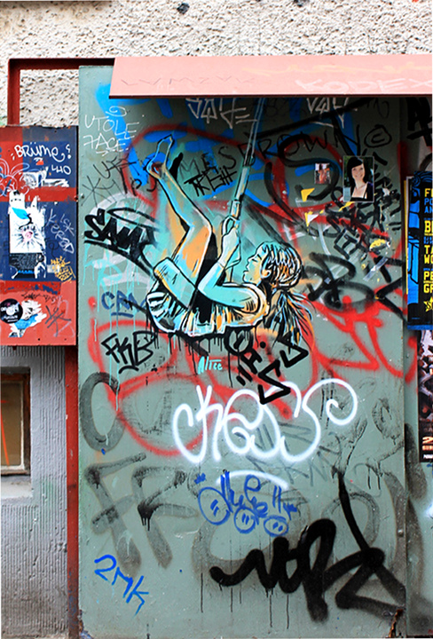 "Street Art by AliCé aka. Alice Pasquini ""Girl on swing"" at Revalerstr. in Berlin"