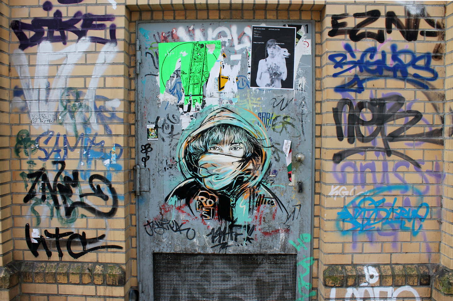 "Street Art by AliCé aka. Alice Pasquini ""Syrian Protest Women"" at Goerlitzerpark. in Berlin"