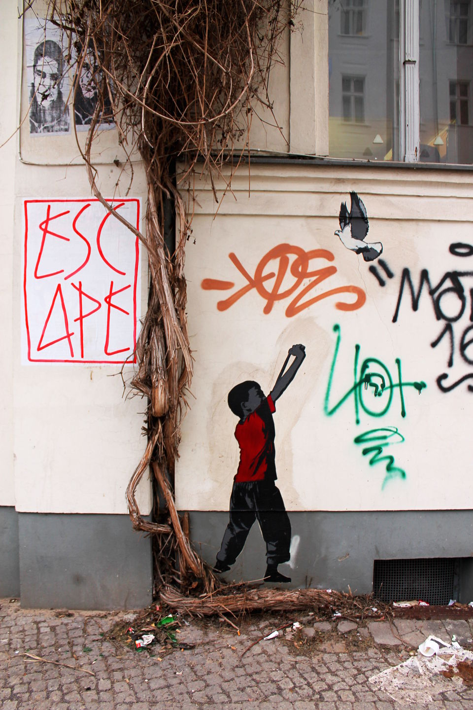 Boy with catapult by Berlin based stencil Street Artist Alias