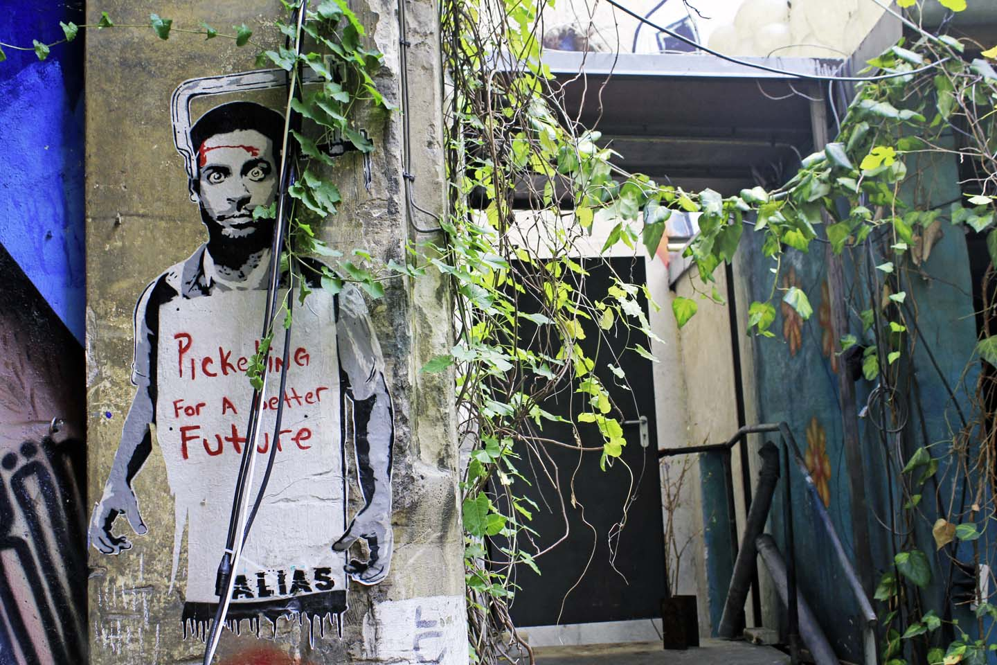 Picketing for a better future by Berlin based stencil Street Artist Alias
