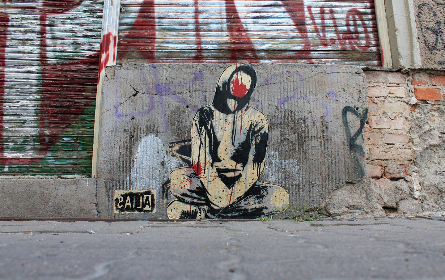 Photo sitting man by Berlin based stencil Street Artist Alias